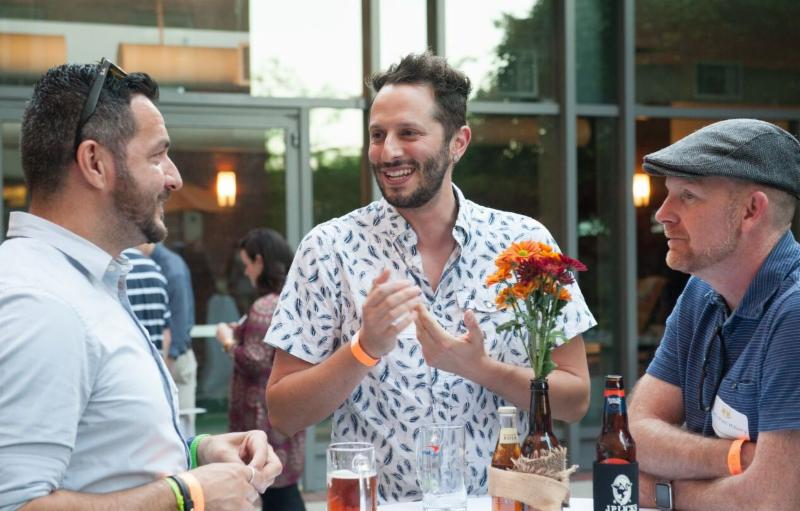 Photo of 3 people talking at the Brookline Chamber of Commerce's 2017 Oktoberfest